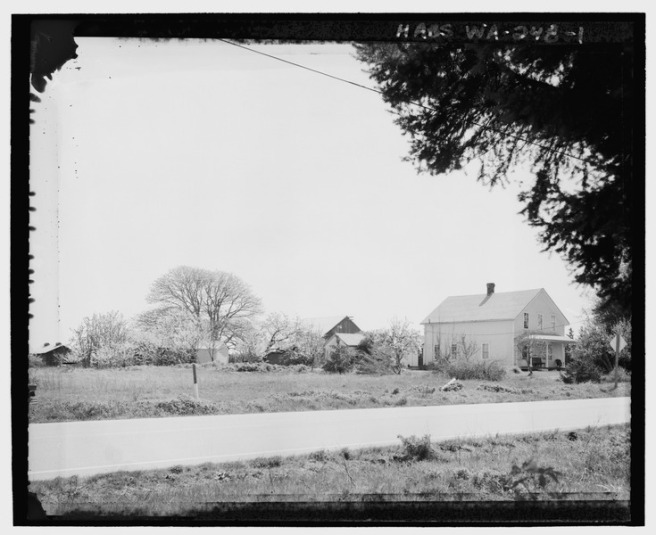 KINETH_FARM_FROM_ACROSS_HIGHWAY_20,_LOOKING_SOUTHEAST._The_Kineth_house_is_seen_on_the_right,_facing_the_highway._Behind_the_house_the_milk_house,_out_house,_and_a_chicken_coop_are_shown